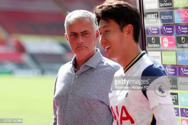 Jose Mourinho, Manager of Tottenham Hotspur interrupts Son Heung-Min of Tottenham Hotspur speaking to the media to tell him Harry Kane of Tottenham...