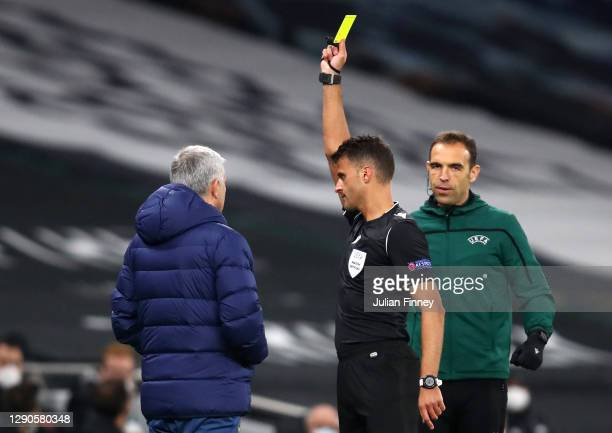 Jose Mourinho, Manager of Tottenham Hotspur is shown the yellow card by Jesus Gil Manzano during the UEFA Europa League Group J stage match between...