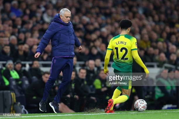 Jose Mourinho Manager of Tottenham Hotspur jumps away as Jamal Lewis of Norwich City runs with the ball during the FA Cup Fifth Round match between...