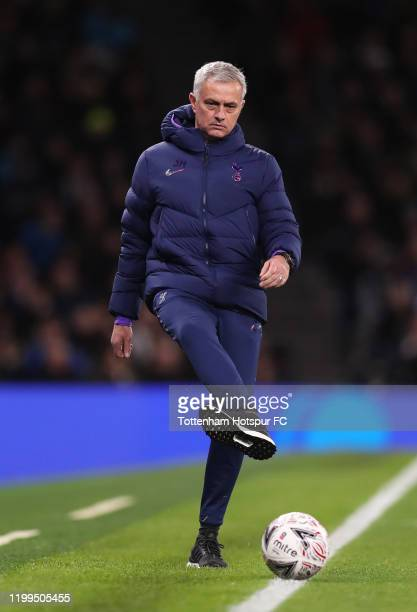 Jose Mourinho manager of Tottenham Hotspur kicks a ball in from the touchline during the FA Cup Third Round Replay match between Tottenham Hotspur...