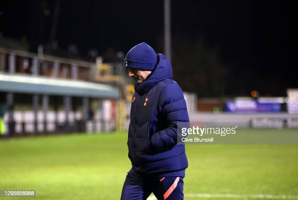 Jose Mourinho, Manager of Tottenham Hotspur leaves the pitch for their half-time break during the FA Cup Third Round match between Marine and...