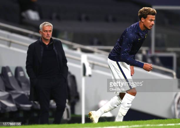 Jose Mourinho, Manager of Tottenham Hotspur looks on as Dele Alli of Tottenham Hotspur warms up at half time during the UEFA Europa League play-off...