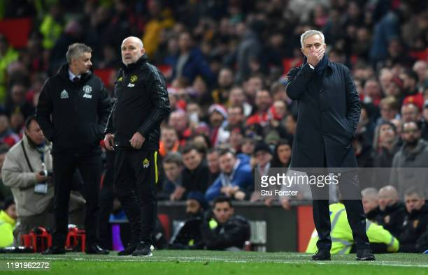 Jose Mourinho, Manager of Tottenham Hotspur reacts as Mike Phelan and Ole Gunnar Solskjaer look on in the dying seconds of the Premier League match...