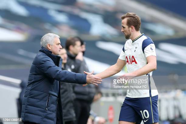 Jose Mourinho, Manager of Tottenham Hotspur shakes hands with Harry Kane of Tottenham Hotspur as he leaves the pitch during the Premier League match...