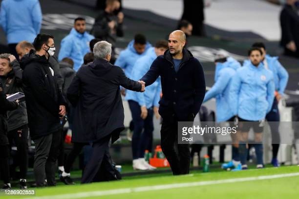 Jose Mourinho Manager of Tottenham Hotspur shakes hands with Pep Guardiola Manager of Manchester City following the Premier League match between...