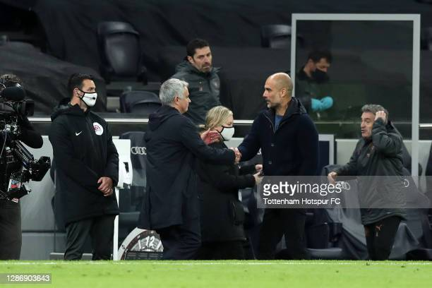 Jose Mourinho, Manager of Tottenham Hotspur shakes hands with Pep Guardiola, Manager of Manchester City following the Premier League match between...