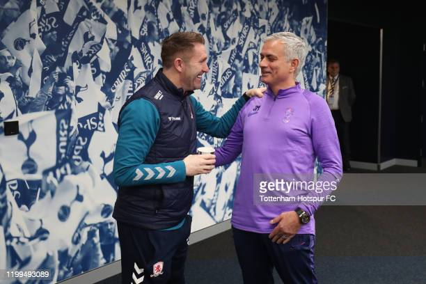 Jose Mourinho, manager of Tottenham Hotspur shakes hands with Robbie Keane, Assistant Manager of Middleborough ahead of the FA Cup Third Round Replay...