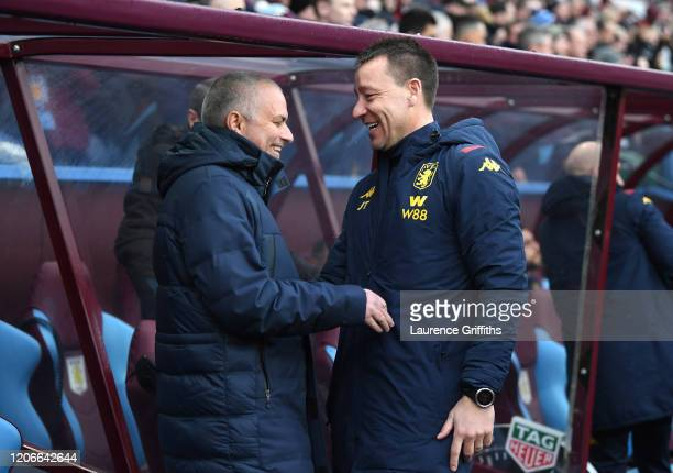 Jose Mourinho, Manager of Tottenham Hotspur shares a joke with Aston Villa assistant Manager John Terry during the Premier League match between Aston...