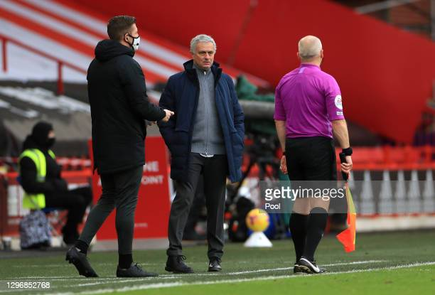 Jose Mourinho, Manager of Tottenham Hotspur speaks to assistant referee Richard West and fourth official Darren Bond during the Premier League match...