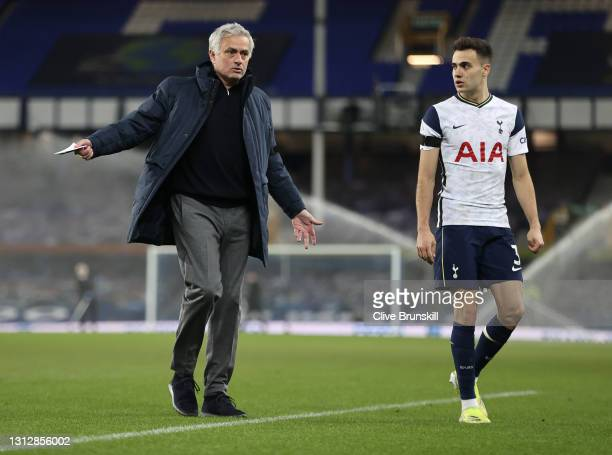 Jose Mourinho, Manager of Tottenham Hotspur speaks to Sergio Reguilon of Tottenham Hotspur as they leave the field of play for the half-time break...