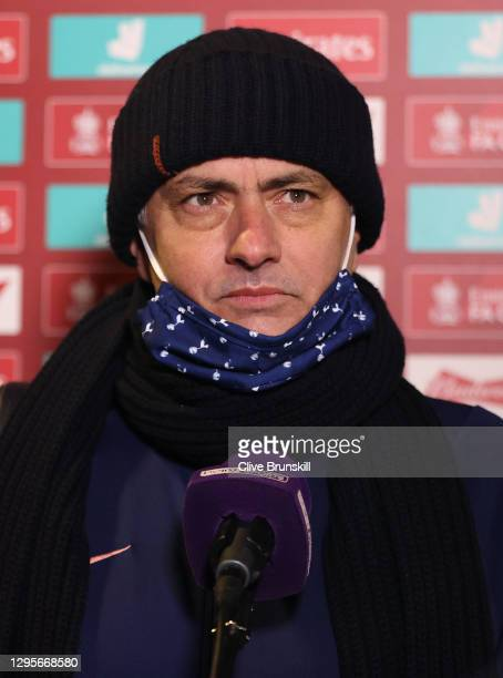 Jose Mourinho, Manager of Tottenham Hotspur speaks to the media as he is interviewed pitch side after the FA Cup Third Round match between Marine and...