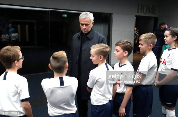 Jose Mourinho Manager of Tottenham Hotspur speaks with the mascots prior to the Premier League match between Tottenham Hotspur and AFC Bournemouth at...