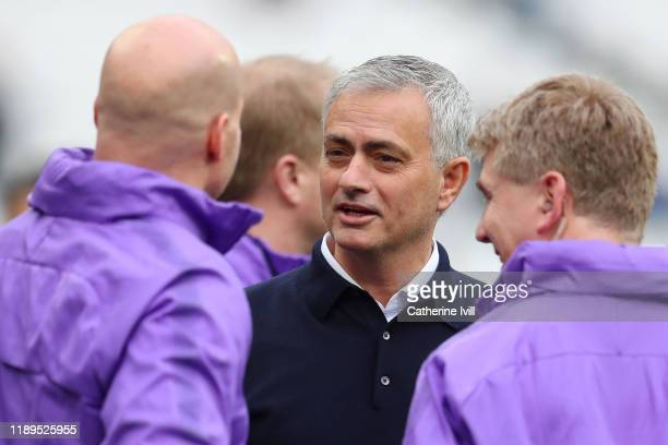 Jose Mourinho Manager of Tottenham Hotspur talks to coaching staff prior to during the Premier League match between West Ham United and Tottenham...