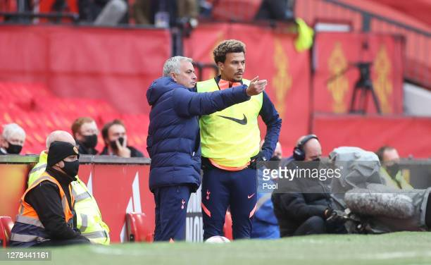 Jose Mourinho, Manager of Tottenham Hotspur talks to Dele Alli of Tottenham Hotspur during the Premier League match between Manchester United and...