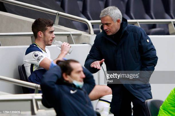 Jose Mourinho, Manager of Tottenham Hotspur talks with Harry Winks of Tottenham Hotspur after he is replaced during the Premier League match between...