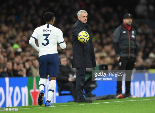 Jose Mourinho Manager of Tottenham Hotspur throws the ball to Danny Rose of Tottenham Hotspur during the Premier League match between Tottenham...