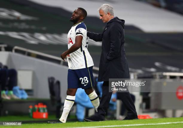 Jose Mourinho Manager of Tottenham Hotspur with Tanguy Ndombele of Tottenham Hotspur as he is substituted off during the Premier League match between...