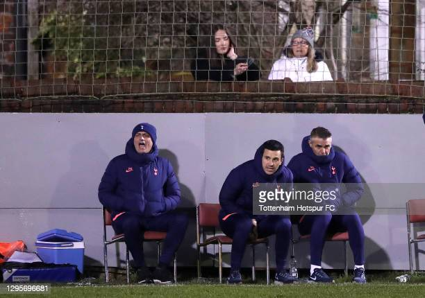 Jose Mourinho, Manager of Tottenham sits with coaching staff in-front of fans watching from their garden during the FA Cup Third Round match between...
