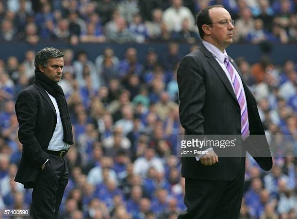 Jose Mourinho of Chelsea and Rafael Benitez of Liverpool watch from the sidelines during the FA Cup semifinal match between Chelsea and Liverpool at...