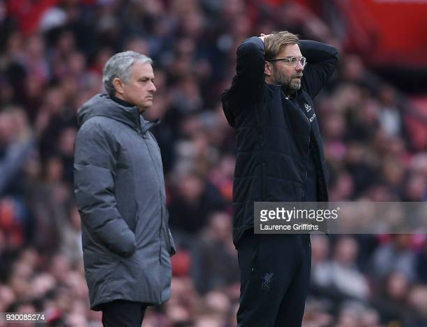 Jose Mourinho of Manchester United and Jurgen Klopp of Liverpool look on during the Premier League match between Manchester United and Liverpool at...