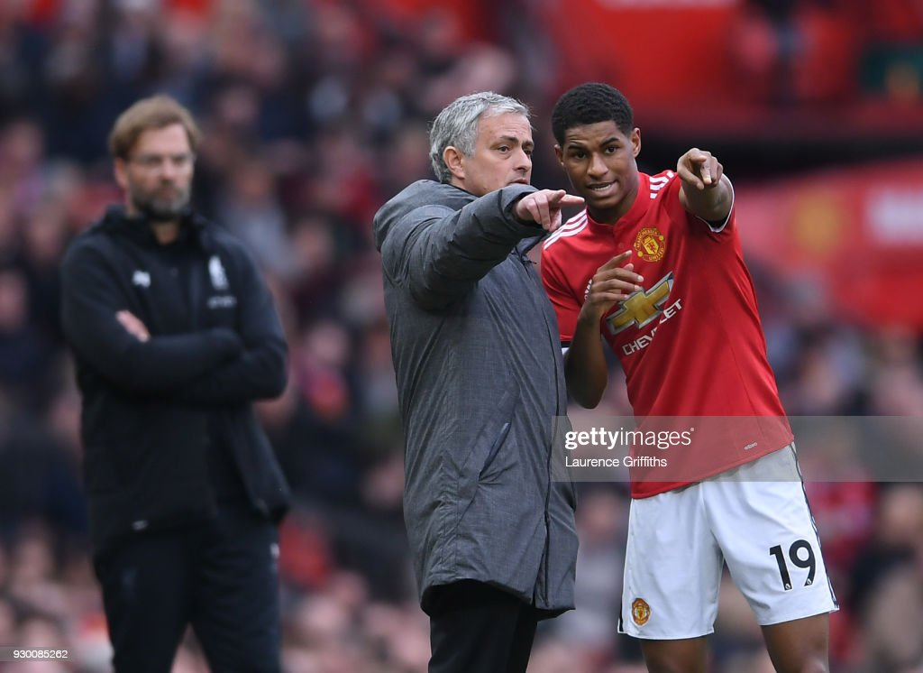 Jose Mourinho of Manchester United speaks to Marcus Rashford as Jurgen Klopp of Liverpool looks on during the Premier League match between Manchester United and Liverpool at Old Trafford on March 10, 2018 in Manchester, England.