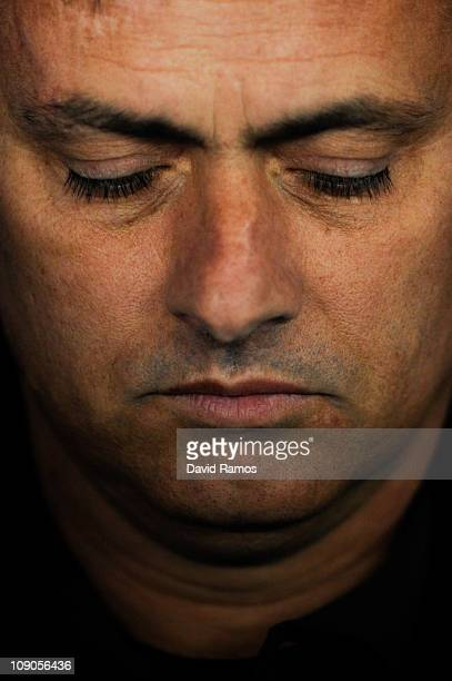 Jose Mourinho of Real Madrid looks down prior La Liga match between RCD Espanyol and Real Madrid at Estadi CornellaEl Prat on February 13 2011 in...