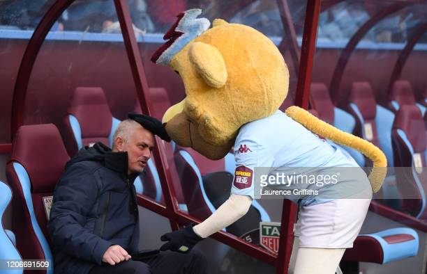 Jose Mourinho of Tottenham Hotspur has a joke with the Bella the Aston Villa club mascot during the Premier League match between Aston Villa and...
