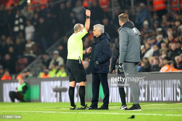 Jose Mourinho of Tottenham Hotspur is shown a yellow card by referee Mike Dean during the Premier League match between Southampton FC and Tottenham...