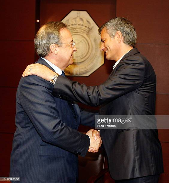 Jose Mourinho poses next to President of Real Madrid Florentino Perez after signing on as new Real Madrid coach at Estadio Santiago Bernabeu on May...