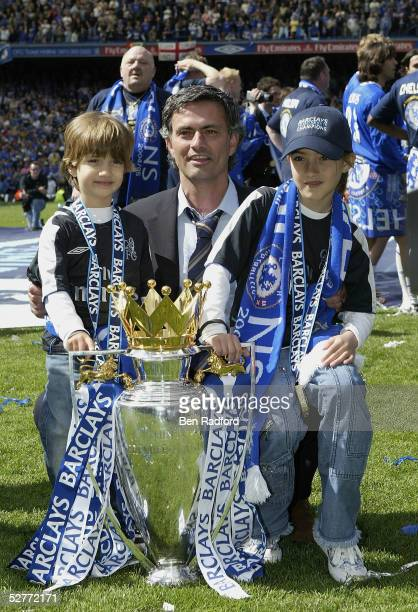 Jose Mourinho poses with his children Zuca and Matilde and the Barclays Premiership Trophy at Stamford Bridge on May 7 2005 in London England