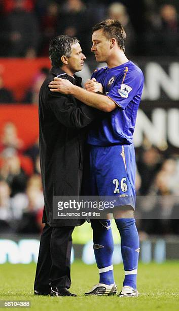 Jose Mourinho, the Chelsea manager, consoles his captain John Terry at the end of the Barclays Premiership match between Manchester United and...