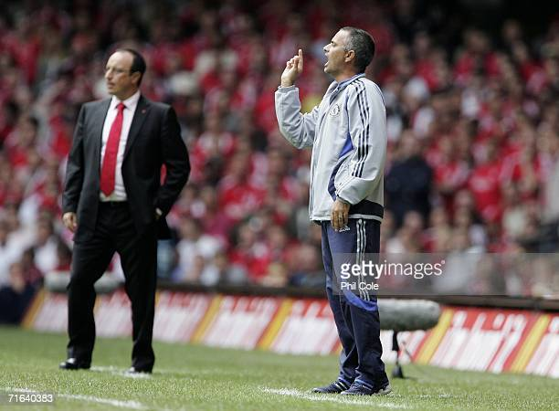 Jose Mourinho the Chelsea Manager gestures to his players as Rafael Benitez the Liverpool Manager looks on during the FA Community Shield match...
