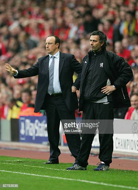 Jose Mourinho the Chelsea manager looks on as Rafael Benitez gives instructions during the UEFA Champions League semifinal second leg match between...