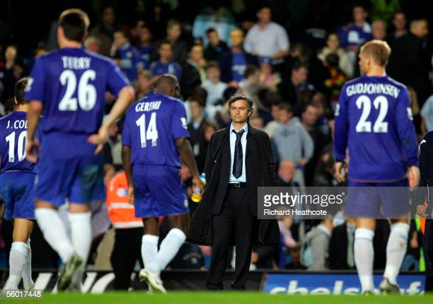Jose Mourinho the Chelsea manager watches his dejected players walk off after losing the penalty shootout during the Carling Cup Third Round match...