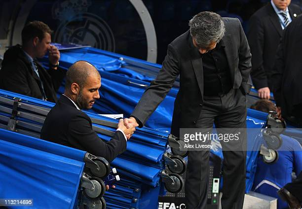 Jose Mourinho the coach of Real Madrid and Pep Guardiola the coach of Barcelona shake hands prior to the UEFA Champions League Semi Final first leg...