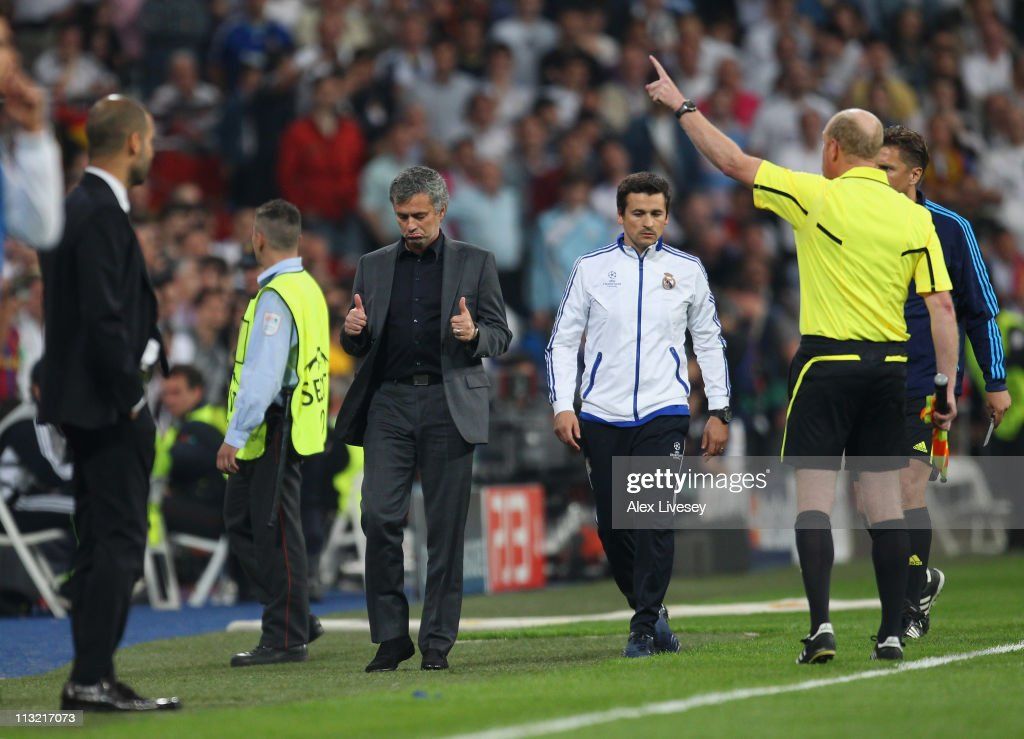 Jose Mourinho the coach of Real Madrid gives a thumbs up to the assistant referee as he is sent off to the stands during the UEFA Champions League Semi Final first leg match between Real Madrid and Barcelona at Estadio Santiago Bernabeu on April 27, 2011 in Madrid, Spain.