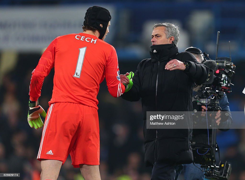 Jose Mourinho the head coach / manager of Chelsea congratulates goalkeeper Petr Cech of Chelsea at the end of the match