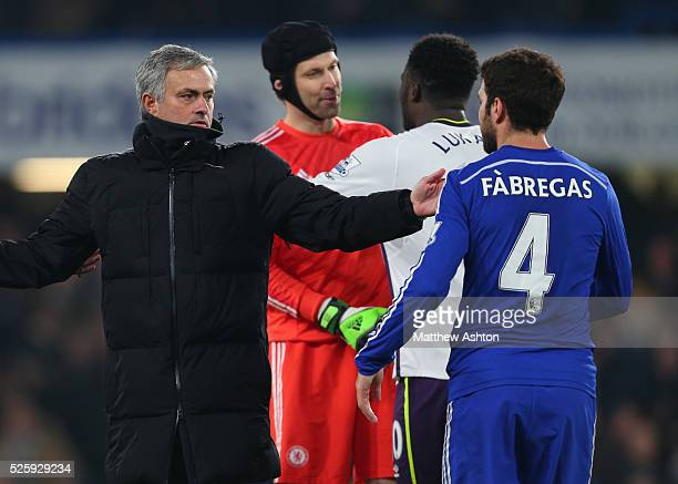Jose Mourinho the head coach / manager of Chelsea with Cesc Fabregas of Chelsea as Petr Cech talks to Romelu Lukaku of Everton