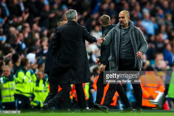 Jose Mourinho the head coach / manager of Manchester United and Pep Guardiola the head coach / manager of Manchester City shake hands at full time...