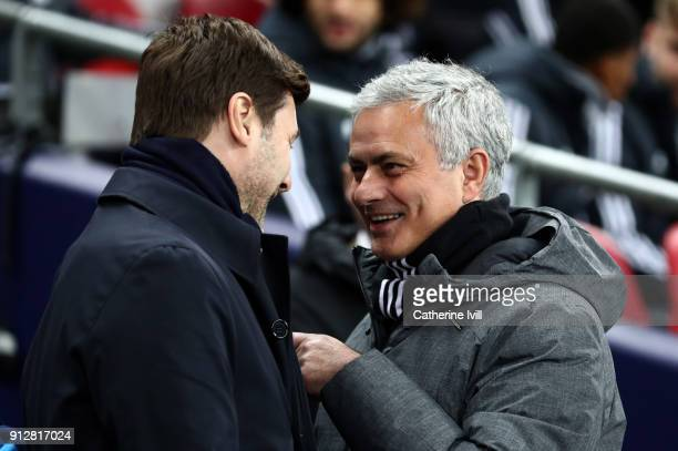 Jose Mourinho the head coach / manager of Manchester United is all smiles as he speaks with Mauricio Pochettino manager / head coach of Tottenham...