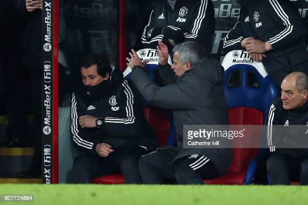 Jose Mourinho the head coach / manager of Manchester United pushes his assistant coach Rui Faria during the Premier League match between Crystal...