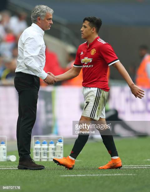 Jose Mourinho the head coach / manager of Manchester United shakes hands with Alexis Sanchez of Manchester United during The Emirates FA Cup Semi...