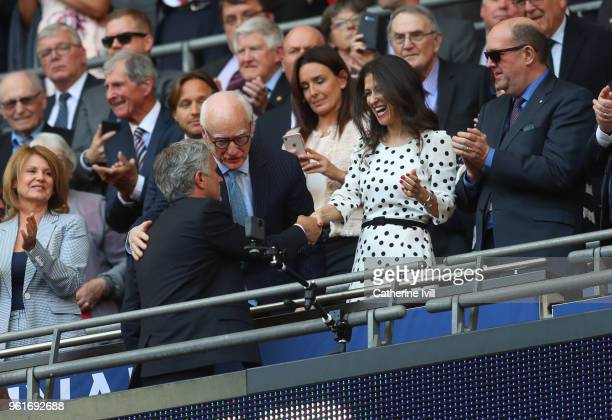 Jose Mourinho the head coach / manager of Manchester United shakes hands with Chelsea diretor Marina Granovskaia as chairman Bruce Buck looks on...