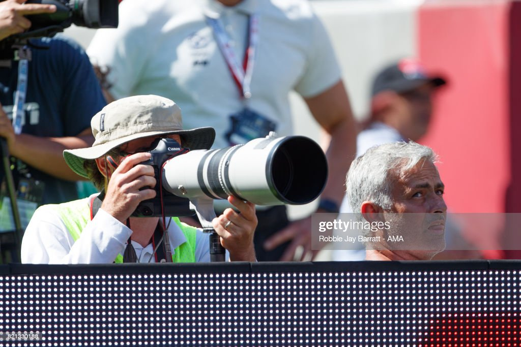 Jose Mourinho the head coach / manager of Manchester United sits in with the photographers to watch the penalties during the International Champions Cup 2017 match between Real Madrid v Manchester United at Levi'a Stadium on July 23, 2017 in Santa Clara, California.