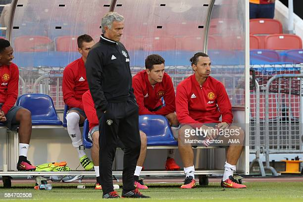 Jose Mourinho the head coach / manager of Manchester United watches the second half with Zlatan Ibrahimovic of Manchester United on the substitutes...