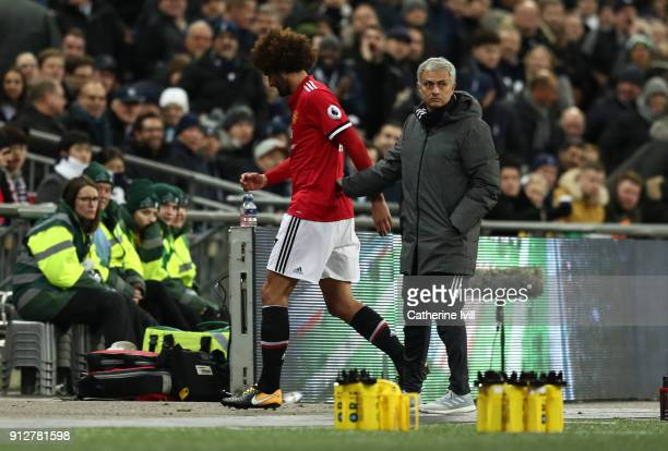 Jose Mourinho the head coach / manager of Manchester United with Marouane Fellaini of Manchester United as he is substituted during the Premier...