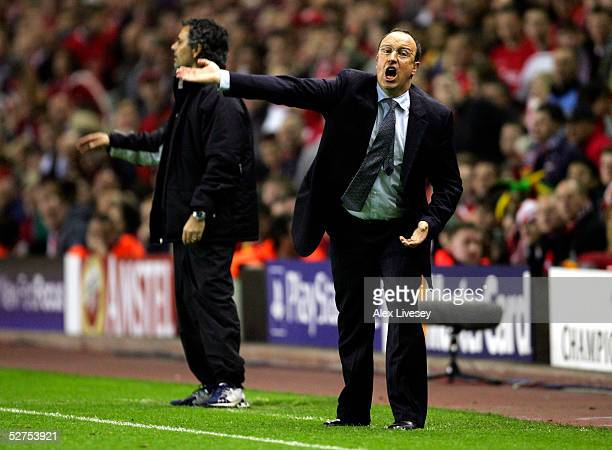 Jose Mourinho the manager of Chelsea and Rafael Benitez the manager of Liverpool shout instructions to their players during the Champions League semi...