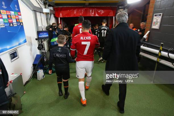 Jose Mourinho the manager of Manchester United walks out from the tunnel with Alexis Sanchez for the UEFA Champions League Round of 16 Second Leg...