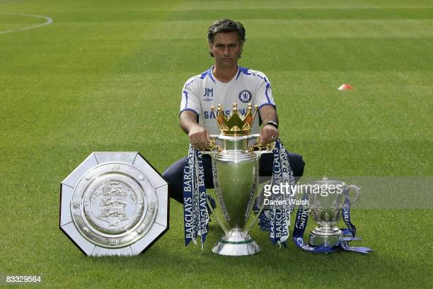 Jose Mourinho with the FA Community Shield the Barclays Premiership Champions trophy and the Carling Cup at Chelsea FC's PreSeason Open Day training...