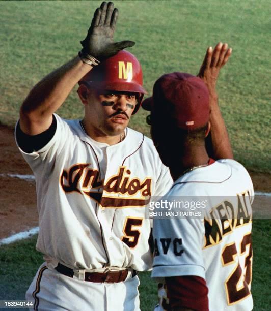 Jose Munoz de Puerto Rico es saludado por su companero Luis de Leon luego de batear un homerun en el cuarto inning del juego contra Republica...